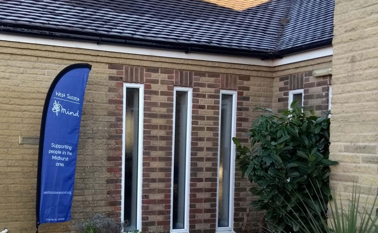 West Sussex Mind flag banner outside church hall building in Midhurst