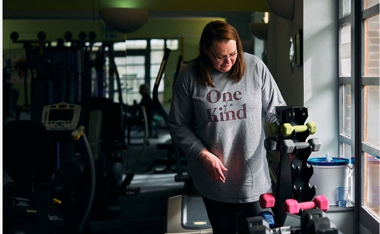 Christine chooses some hand-weights in a gym
